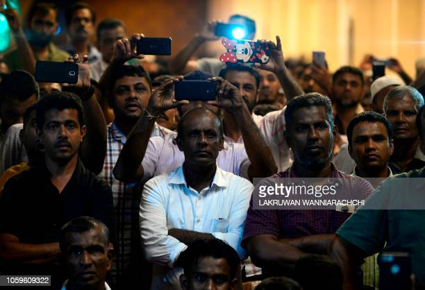 Supporters of ousted Sri Lanka's Prime Minister Ranil Wickremesinghe gather at the prime minister's official residence in Colombo early November 10...