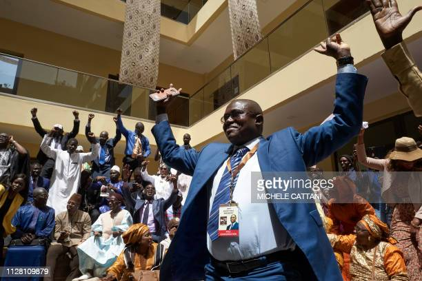 TOPSHOT Supporters of outgoing president Macky Sall celebrate after the announcement of the provisional results of Senegal presidential elections on...