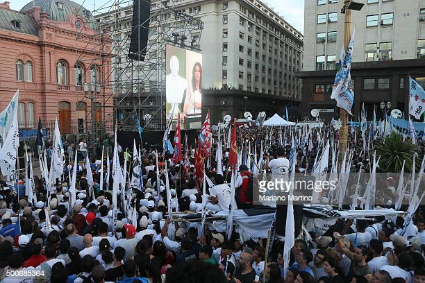 Supporters of Outgoing President of Argentina Cristina Fernandez de Kirchner attend a farewell speech at Casa Rosada on December 09 2015 in Buenos...