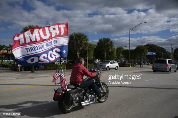 Supporters of outgoing US President Donald Trump wait for his arrival to Mar-a-Lago in Palm Beach, Florida on January 20, 2021.