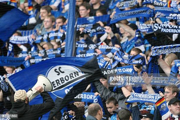 Supporters of Paderborn cheer their team during the 3. Liga match between SC Paderborn and Werder Bremen II at the Paragon Arena on May 12, 2009 in...