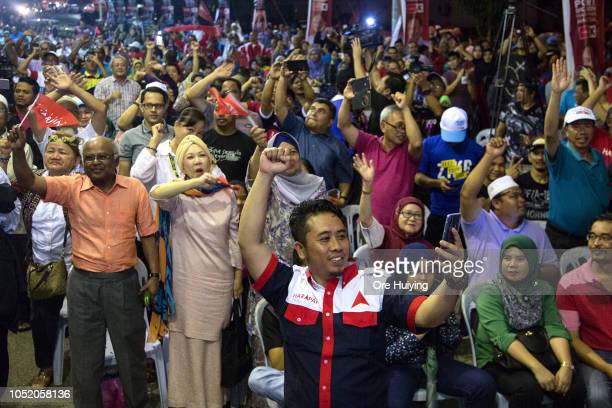 Supporters of Pakatan Harapan party celebrate Anwar Ibrahim's victory outside the party's headquarters on October 13 2018 in Port Dickson Malaysia...