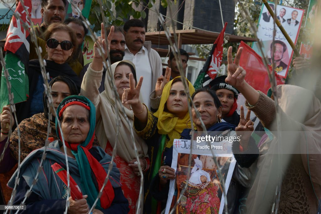 Supporters of Pakistan Awami Tehreek Pakistan Peoples Party and Pakistan TehreekeInsaf carry their party flags they protest against Model Town...