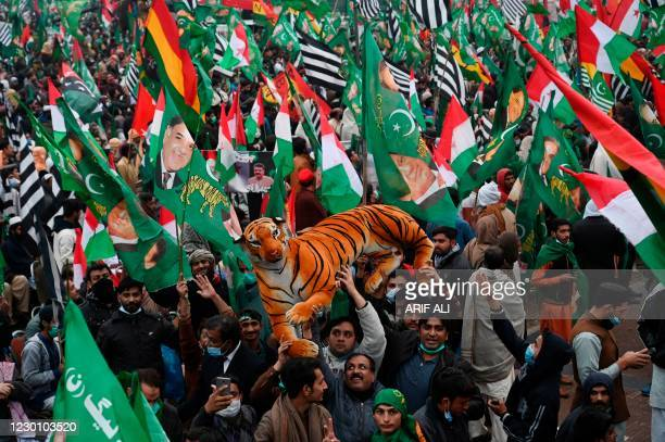 Supporters of Pakistan Democratic Movement gather during an anti-government rally in Lahore on December 13, 2020. -