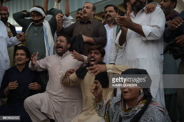 Supporters of Pakistan Muslim LeagueNawaz chant slogans after the sentencing decision against former prime minister Nawaz Sharif during a protest in...