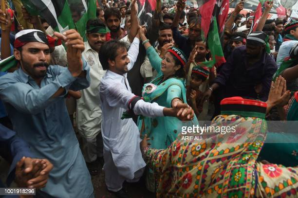 Supporters of Pakistan Peoples Party dance during an election campaign rally in Lahore on July 19 ahead of Pakistan's election Pakistan will hold a...