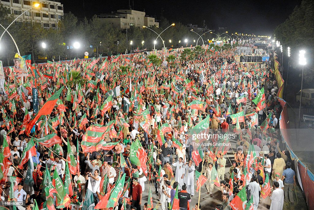 Supporters of Pakistan Tehrik e Insaf (PTI) gather to show their support the PTI chairman Imran Khan, who was heavy injured at a rally in Lahore after having fallen 15 feet, on May 9, 2013 in Islamabad, Pakistan. The general election will be held on May 11.