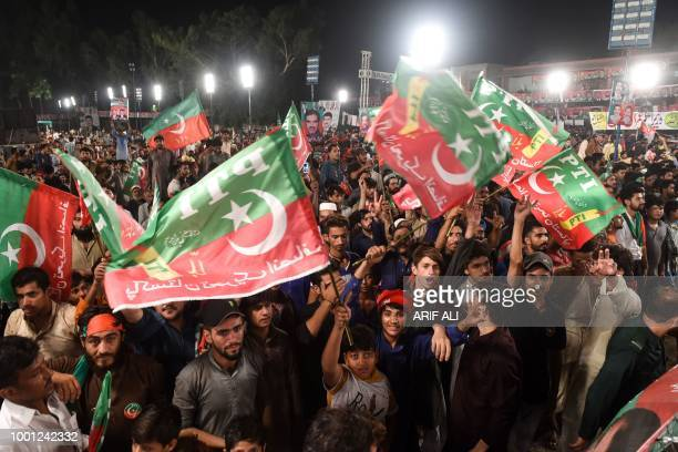 Supporters of Pakistani cricket starturnedpolitician and head of the Pakistan TehreekeInsaf Imran Khan gather at his political campaign rally for the...