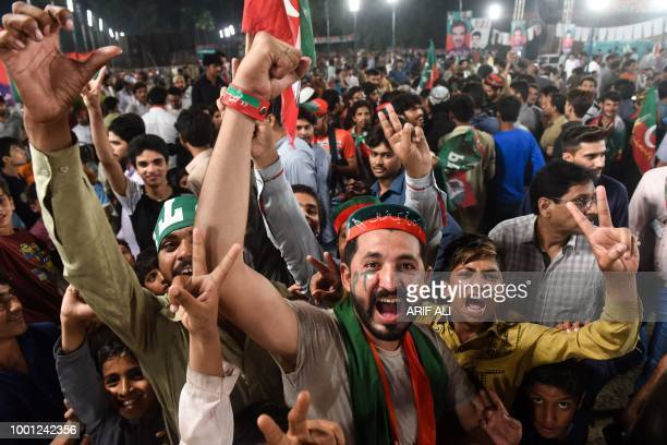 TOPSHOT Supporters of Pakistani cricket starturnedpolitician and head of the Pakistan TehreekeInsaf Imran Khan gather at his political campaign rally...