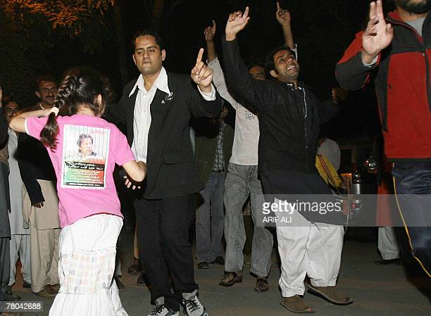 Supporters of Pakistani cricketeerturnedpolitician Imran Khan celebrate outside his residence in Lahore 21 November 2007 after releasing the Khan...