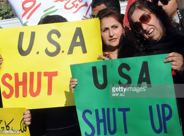Supporters of Pakistani former cricketer turned politician Imran Khan of Pakistan Tehreek-i-Insaaf carry placards as they shout anti-US slogans...