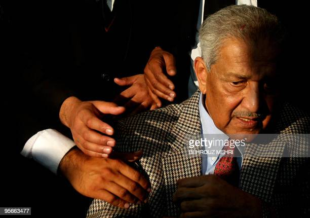 Supporters of Pakistani nuclear scientist Abdul Qadeer Khan try to shake hands with him during a ceremony at the Rawalpindi high court on January 9...