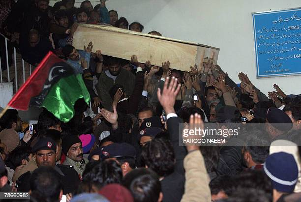 Supporters of Pakistani opposition leader Benazir Bhutto carry her coffin after her body was released from the hospital in Rawalpindi 27 December...
