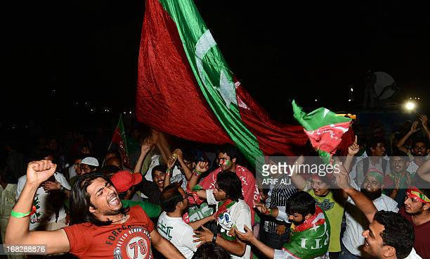 Supporters of Pakistani politician and former cricketer Imran Khan, gather outside a hospital where Khan is admited in Lahore late May 7, 2013....