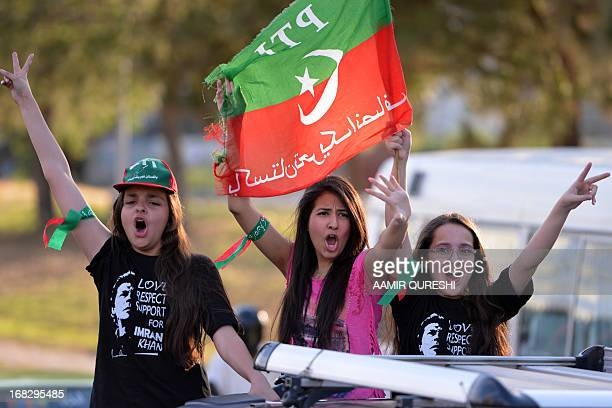 Supporters of Pakistani politician and former cricketer Imran Khan flash victory signs as they take part in an election campaign rally in Islamabad...