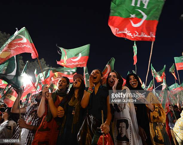 Supporters of Pakistani politician and former cricketer Imran Khan cheer as they wait to listen Khan video link address from a hospital during last...