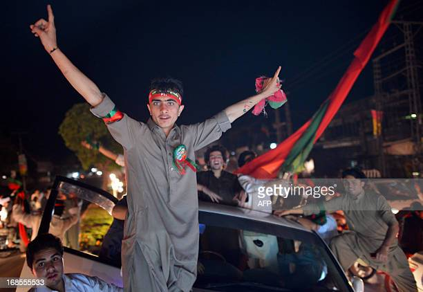 Supporters of Pakistani politician and former cricketer Imran Khan wave flags as they take part in a rally in Peshawar on May 11, 2013. Pakistan...