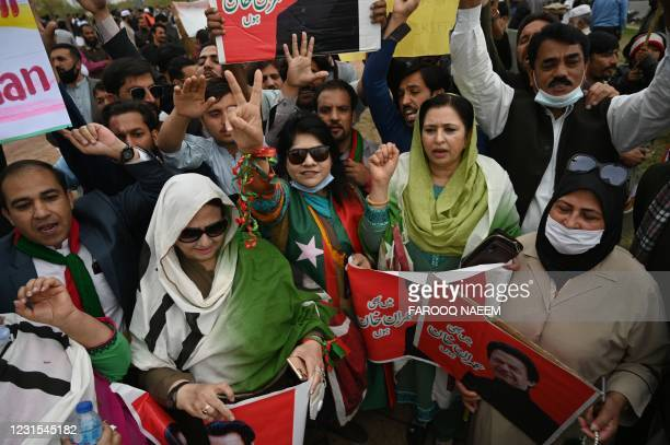 Supporters of Pakistani Prime Minister Imran Khan gather outside the National Assembly during vote of confidence session, in Islamabad on March 6,...