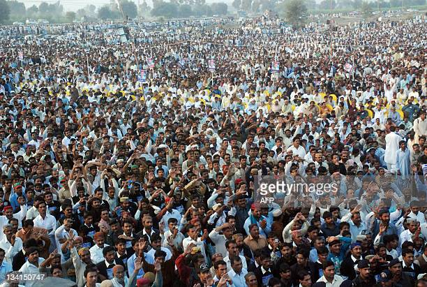 Supporters of Pakistan's exforeign minister Shah Mehmood Qureshi gather during a public meeting in the southern town of Ghotki on November 27 2011...