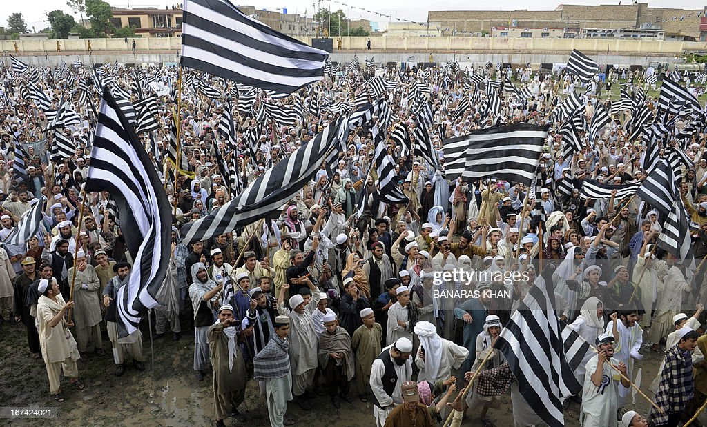 Supporters of Pakistan's Islamist party Jamiat Ulema-e-Islam Fazl (JUI-F) hold flags during an election meeting in Quetta on April 25 , 2013. Amnesty International called on Pakistan to investigate a wave of attacks and threats against politicians and election workers that have marred the run-up to key polls next month.