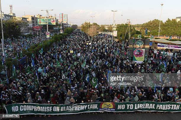 Supporters of Pakistan's second largest Islamist party the JamaateIslami carry banners and shout slogans as they take part in a protest against the...