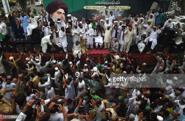 Supporters of Pakistan's Sunni Muslim TehreekeLabaik Pakistan party gather in a rally against alleged election rigging in Lahore on August 6 2018...