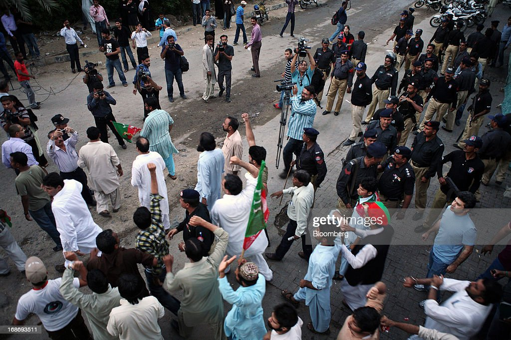 Supporters of Pakistan's Tehreek-e-Insaf (PTI) chairman Imran Khan shout slogans during a demonstration in Karachi, Pakistan, on Monday, May 13, 2013. Nawaz Sharif was headed for a record third term as prime minister of Pakistan as unofficial results from a landmark election gave him the convincing win he sought to tackle a slumping economy and growing militancy. Photographer: Asim Hafeez/Bloomberg via Getty Images