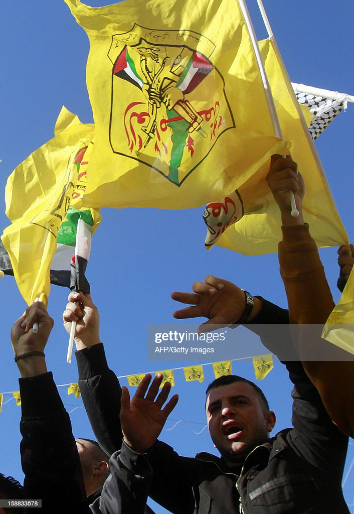 Supporters of Palestinian leader Mahmud Abbas wave the Fatah movement flag in front of the Church of the Nativity in the West Bank city of Bethlehem, on December 31, 2012, during celebrations marking the 48th anniversary of the movement's founding.