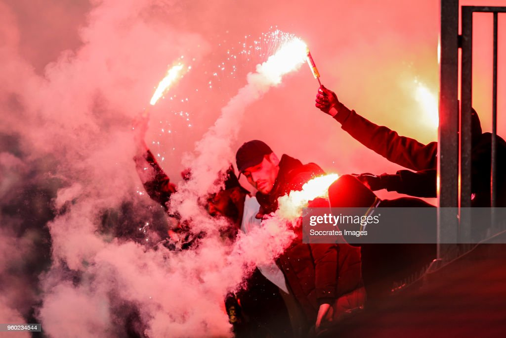 Supporters of Paris Saint Germain, with fireworks during the French League 1 match between Caen v Paris Saint Germain at the Stade Michel d Ornano on May 19, 2018 in Caen France