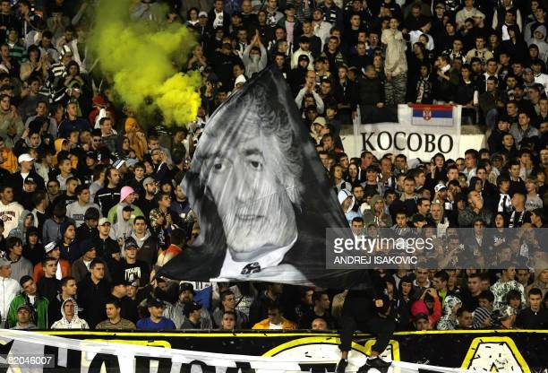 Supporters of Partizan Belgrade wave a flag with a photo of Radovan Karadzic during a friendly soccer match between Partizan Belgrade and Olympic...