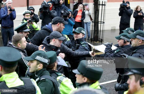 Supporters of Paul McIntyre a man who appeared in court charged with the murder of journalist Lyra McKee clash with police officers outside...
