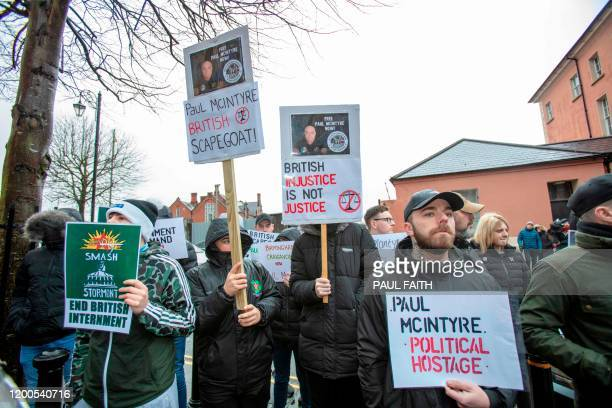 Supporters of Paul McIntyre a man who appeared in court charged with the murder of journalist Lyra McKee are seen outside Londonderry Magistrates...
