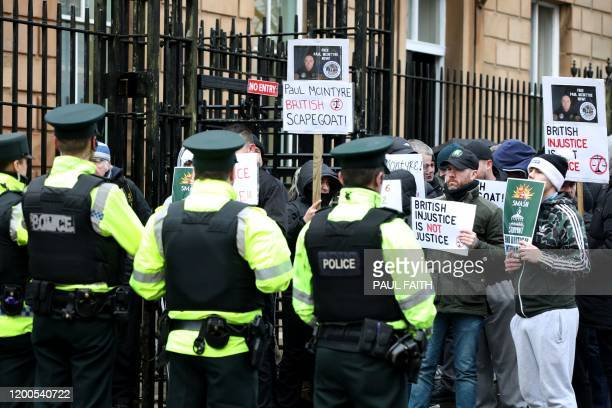 Supporters of Paul McIntyre a man who appeared in court charged with the murder of journalist Lyra McKee face police officers outside Londonderry...