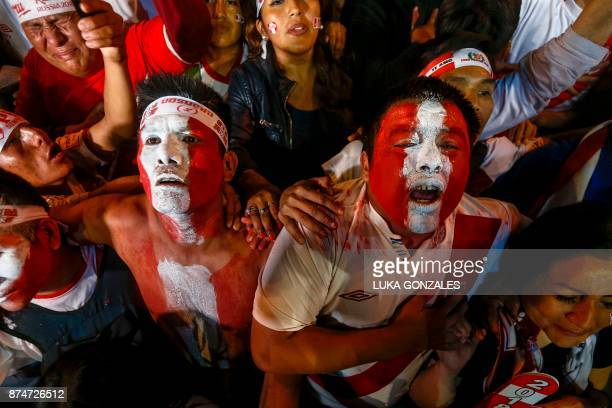 Supporters of Peru celebrate a goal against New Zealand during the 2018 World Cup qualifying playoff second leg football match at the Plaza Mayor...