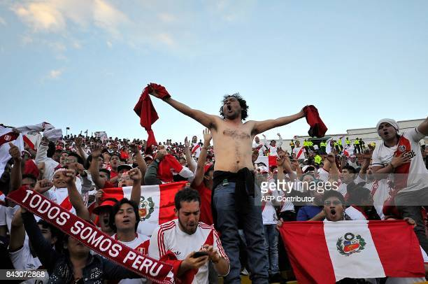 Supporters of Peru celebrate at the end of the 2018 World Cup football qualifier match against Ecuador in Quito on September 5 2017 / AFP PHOTO /...