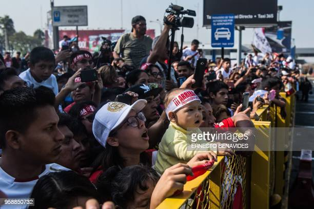 Supporters of Peru's national football team captain Paolo Guerrero wait for his arrival at the Jorge Chavez airport in Lima on May 15 2018 a day...