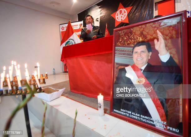 Supporters of Peruvian expresident Alan Garcia participate in a memorial service at the American Popular Revolutionary Alliance party headquarters in...