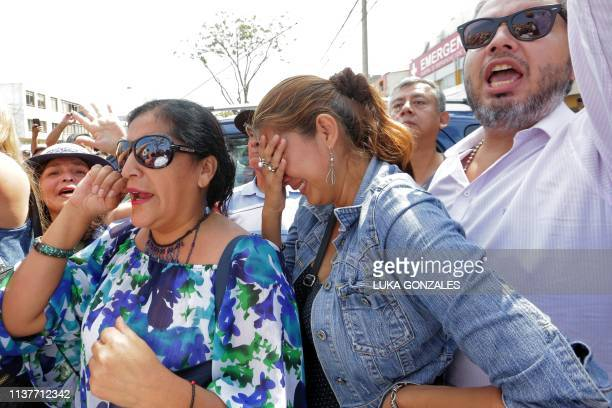 Supporters of Peruvian expresident Alan Garcia react outside the Casimiro Ulloa Emergency Hospital in Lima after learning that he died on April 17...