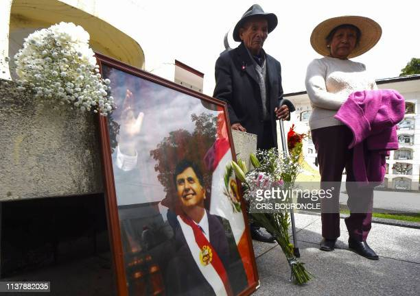 TOPSHOT Supporters of Peruvian expresident Alan Garcia setup a memorial at the city cemetery in Huancayo 350 kilometres east of Lima on April 18 2019...