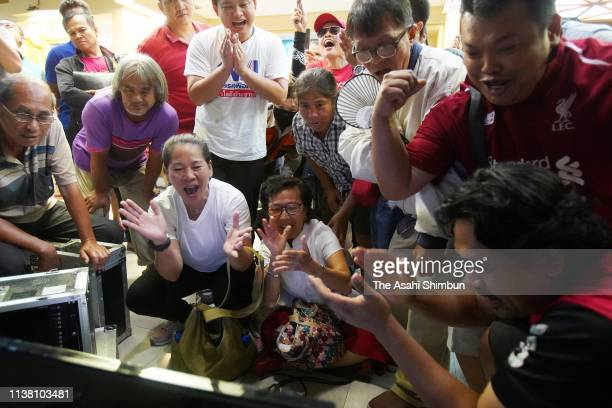 Supporters of Pheu Thai party celebrate as the vote counting continues on March 24 2019 in Bangkok Thailand Around 50 million voters headed to the...