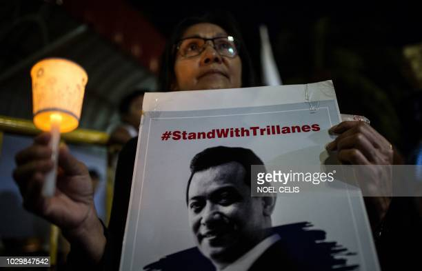 TOPSHOT Supporters of Philippine Senator Antonio Trillanes hold a rally in front of the Senate building in Manila on September 9 2018 Trillanes who...