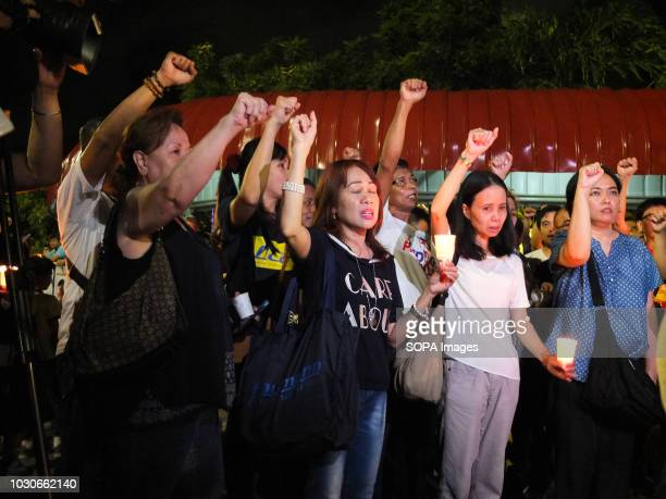 Supporters of Philippine Senator Antonio Trillanes raise their fist showing their support to the embattled Senator Supporters of the beleaguered...