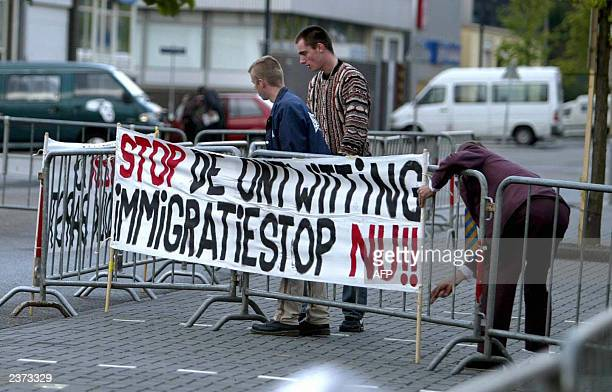 Supporters of Pim Fortuyn install banners in front of the court of Amsterdam 18 July 2003 A Dutch appeal court confirmed an 18year sentence for the...