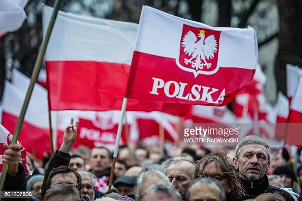 Supporters of Poland's ruling party Law and Justice rally for a progovernment demonstration December 13 2015 in Warsaw AFP PHOTO / WOJTEK RADWANSKI /...