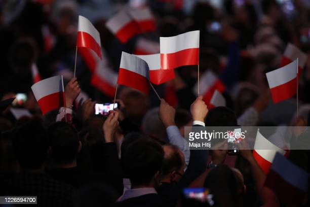 Supporters of Polish President Andrzej Duda celebrate following initial election results during Poland's Presidential elections runoff on July 12,...