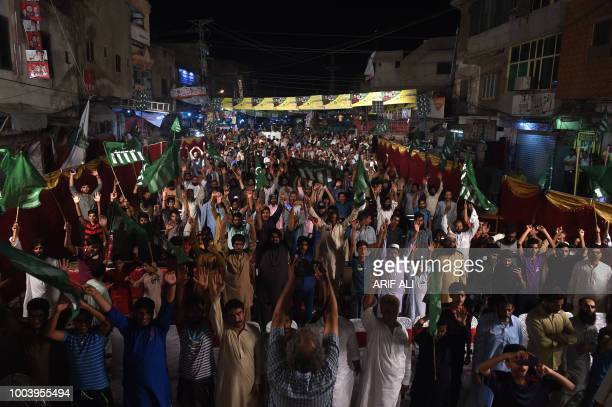 Supporters of political party AllahoAkbar Tehreek chant slogans during the election campaign meeting in Lahore on July 22 ahead of the general...
