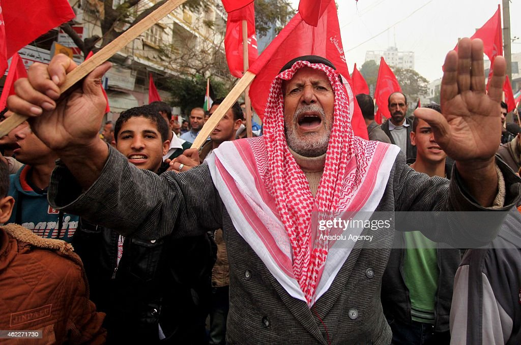 Supporters of Popular Front for the Liberation of Palestine (PFLP) march on the death anniversary of George Habash, founder of PFLP, in Gaza City, Gaza on January 26, 2015.