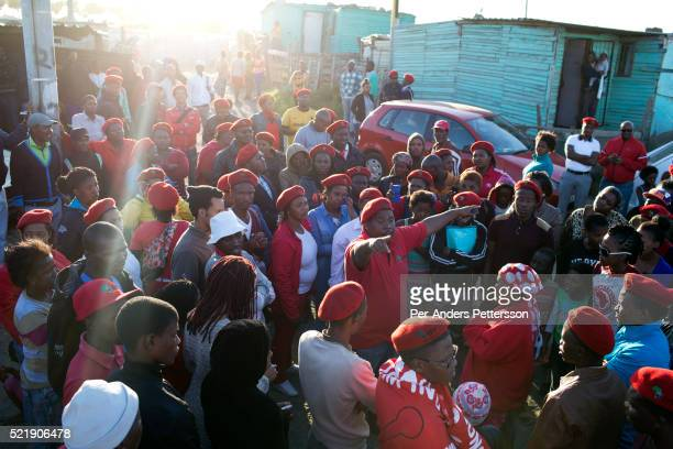 Supporters of populist South African leader Julius Malema go door to door to recruit new members in Gugulethu a township outside Cape Town South...