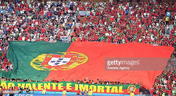 Supporters of Portugal cheer up during the UEFA Euro 2016 semi final match between Portugal and Wales at Stade de Lyon in Lyon France on July 6 2016