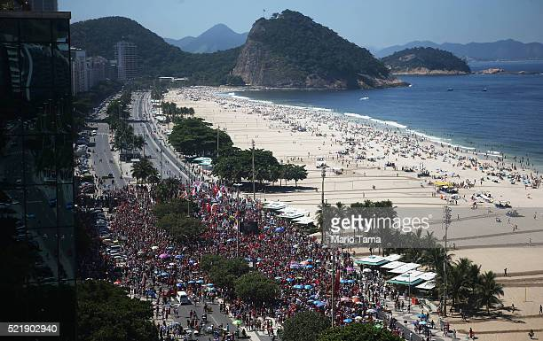 Supporters of President Dilma Rousseff march during an antiimpeachment protest and baile funk dance party along Copacabana Beach on April 17 2016 in...